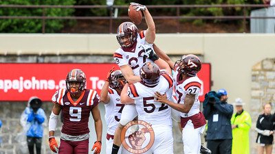 Dalton Keene (29) celebrates with his teammates after catching the first touchdown of the day for the offense. (Mark Umansky/TheKeyPlay.com)
