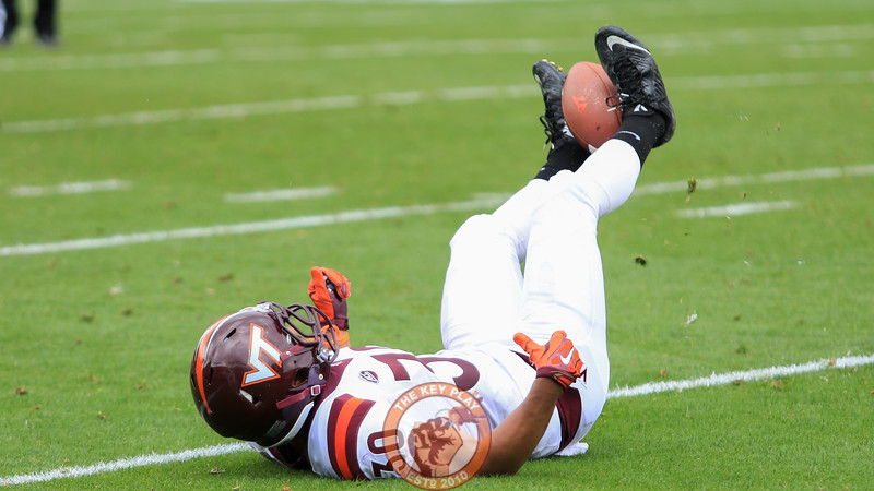 "WR Jordan Jefferson winds on on the ground after ""catching"" an incomplete pass with his feet. (Mark Umansky/TheKeyPlay.com)"