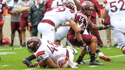 Tavante Beckett (14) looks on as D.J. Reid falls to the turf with the ball (Mark Umansky/TheKeyPlay.com)