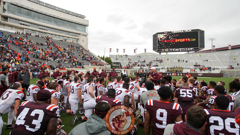 Players kneel at midfield to listen to head coach Justin Fuente speak to them one last time before finishing the spring practice sessions for the year. (Mark Umansky/TheKeyPlay.com)