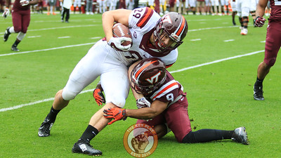Dalton Keene (29) gets tackled by Khalil Ladler. (Mark Umansky/TheKeyPlay.com)