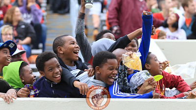 A group of young fans celebrate as they get put on Hokievision. (Mark Umansky/TheKeyPlay.com)