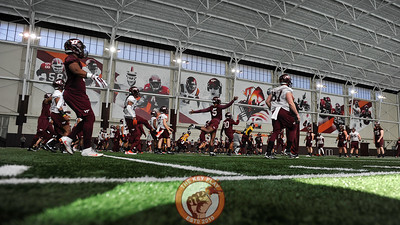 Members of the Virginia Tech Hokies get stretched out inside the Beamer Barn prior to their second practice of the season. (Michael Shroyer/ TheKeyPlay.com)