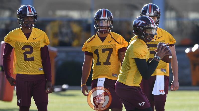 Virginia Tech Hokies quarterback A.J. Bush (6) demonstrates drops back as his fellow quarterbacks look on. (Michael Shroyer/ TheKeyPlay.com)