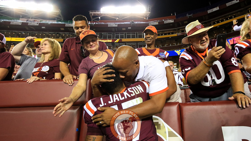 QB Josh Jackson greets his family in the front row after the game. (Mark Umansky/TheKeyPlay.com)