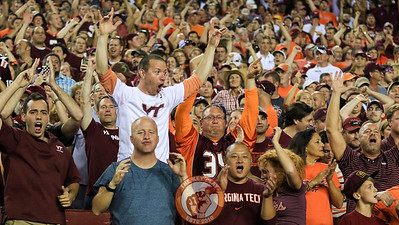 Virginia Tech fans in the stands jump as Enter Sandman is played during a timeout with West Virginia looking to tie. (Mark Umansky/TheKeyPlay.com)