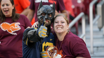 A pair of fans pose in the stands during warmups. (Mark Umansky/TheKeyPlay.com)