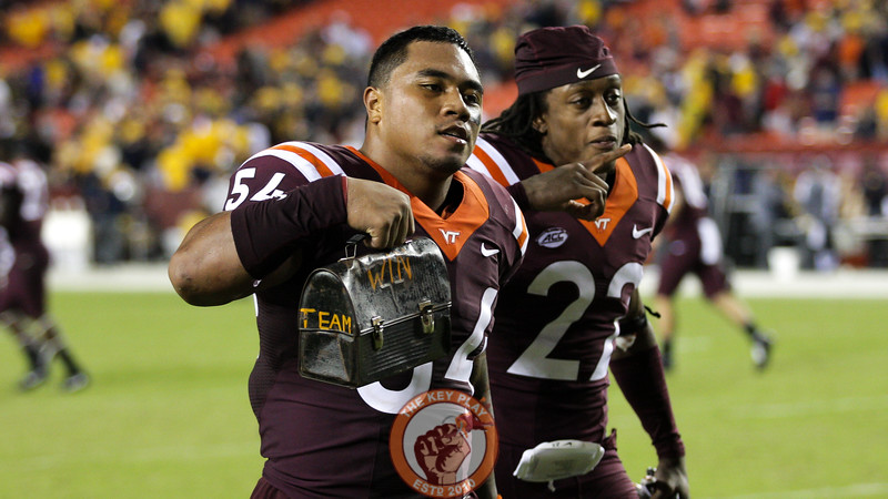Andrew Motuapuaka holds up the Virginia Tech lunchpail after the end of the game. (Mark Umansky/TheKeyPlay.com)