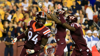 DE Trevon Hill (94) celebrates after registering his first sack of the season. (Mark Umansky/TheKeyPlay.com)