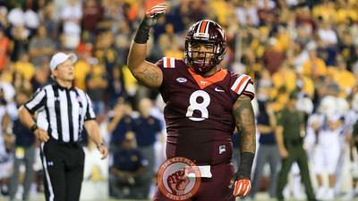 Ricky Walker gestures to the Virginia Tech sidelines to urge them on as Enter Sandman plays. (Mark Umansky/TheKeyPlay.com)