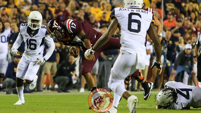 QB Josh Jackson is tripped up and tackled during a run in the second half. (Mark Umansky/TheKeyPlay.com)