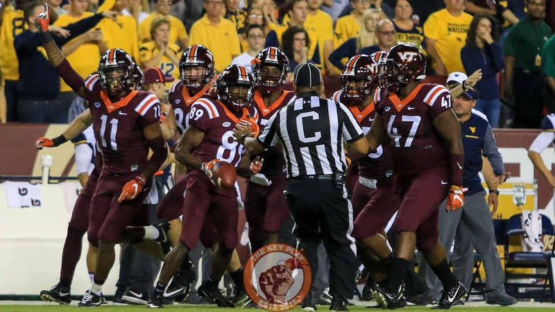The Hokies down a punt near the WVU sidelines before handing the ball to a referee. (Mark Umansky/TheKeyPlay.com)