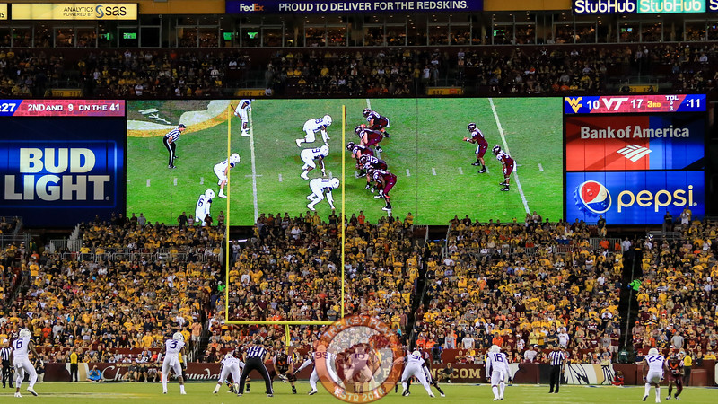 Fans in FedEx field watch the action in the second half. (Mark Umansky/TheKeyPlay.com)