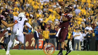 QB Josh Jackson attempts a pass as the WVU defense starts to close in on him. (Mark Umansky/TheKeyPlay.com)
