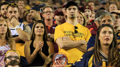 West Virginia fans in the stands start to feel disenheartened as Virginia Tech drives the ball downfield looking for the go-ahead score. (Mark Umansky/TheKeyPlay.com)