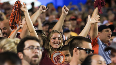 A Virginia Tech fan poses in the stands during a break in the action. (Mark Umansky/TheKeyPlay.com)