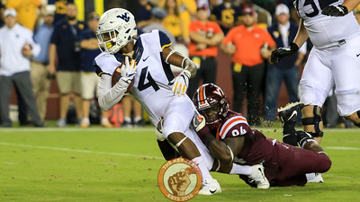 DE Trevon Hill drags down West Virginia's Kennedy McKoy. (Mark Umansky/TheKeyPlay.com)