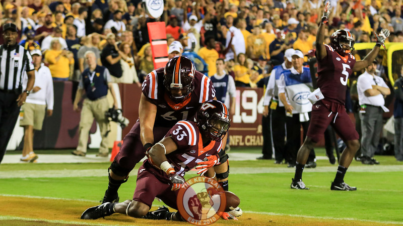 Deshawn McClease is picked up by Kyle Chung after scoring Virginia Tech's second touchdown of the game. (Mark Umansky/TheKeyPlay.com)