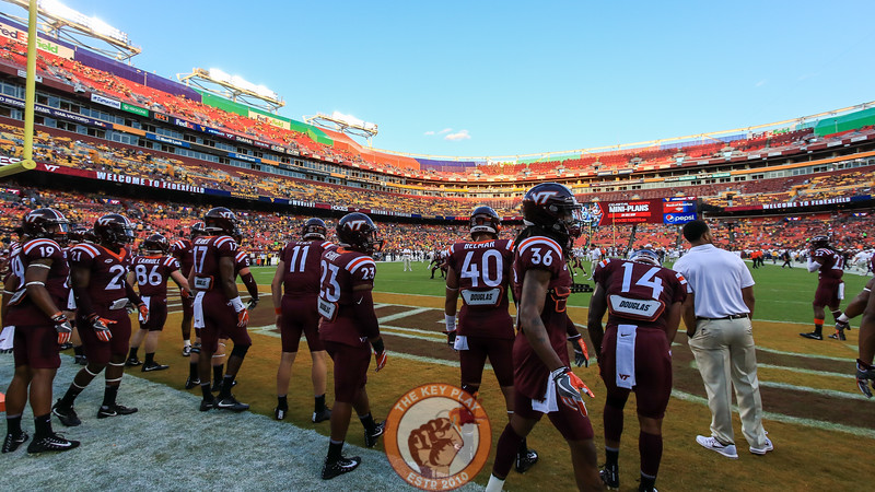 The Hokies warm up on the field as the crowd starts to file into the stadium. (Mark Umansky/TheKeyPlay.com)