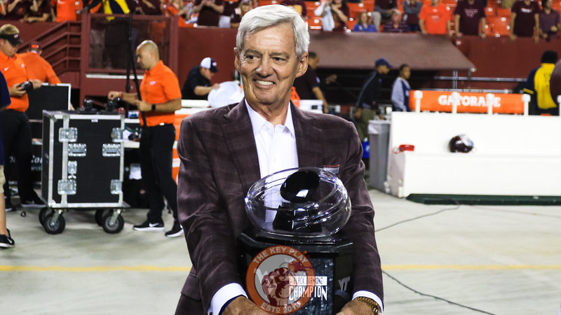 Former Virginia Tech head coach Frank Beamer smiles as he holds onto the Black Diamond Trophy before presenting it to the team. (Mark Umansky/TheKeyPlay.com)