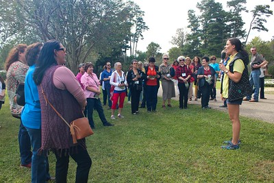 LSU AgCenter Botanic Garden Coordinator Katie Guitreau gives the Women's Leadership Committee Fall Conference attendees an overview of the upcoming tour.