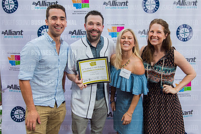 Brennen Smith, from left, Jamie Steven, Emmi Jensen and Adriane Blum of Ookla, LLC, recipient of the first place award for 2017 Washington's Best Workplaces (50-99 employees), pose during the Puget Sound Business Journal's Washington's Best Workplaces event at Safeco Field in Seattle on Thursday, August 3 , 2017. (BUSINESS JOURNAL PHOTO | Dan DeLong)