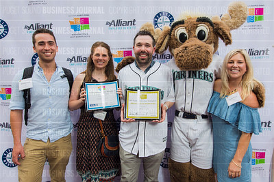 Brennen Smith, from left, Adriane Blum, Jamie Steven and Emmi Jensen of Ookla, LLC, recipient of the first place award for 2017 Washington's Best Workplaces (50-99 employees), pose with the Mariner Moose during the Puget Sound Business Journal's Washington's Best Workplaces event at Safeco Field in Seattle on Thursday, August 3 , 2017. (BUSINESS JOURNAL PHOTO | Dan DeLong)