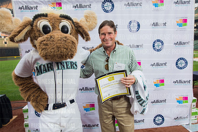 Bill Reid of Walsh Construction Co., recipient of the first place award for 2017 Washington's Best Workplaces (100-249 employees), poses with the Mariner Moose during the Puget Sound Business Journal's Washington's Best Workplaces event at Safeco Field in Seattle on Thursday, August 3 , 2017. (BUSINESS JOURNAL PHOTO | Dan DeLong)