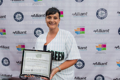 Tamra Rieger of Evergreen Home Loans, recipient of the second place award for 2017 Washington's Best Workplaces (250+ employees), pose during the Puget Sound Business Journal's Washington's Best Workplaces event at Safeco Field in Seattle on Thursday, August 3 , 2017. (BUSINESS JOURNAL PHOTO | Dan DeLong)