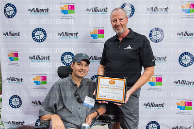 Eric Bolstad, left, and Tom Griffith of Absolute Mortgage, recipient of the third place award for 2017 Washington's Best Workplaces (100-249 employees), poses during the Puget Sound Business Journal's Washington's Best Workplaces event at Safeco Field in Seattle on Thursday, August 3 , 2017. (BUSINESS JOURNAL PHOTO | Dan DeLong)