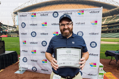 Shawn Plaster of Plaster Group LLC, recipient of the second place award for 2017 Washington's Best Workplaces (50-99 employees), poses during the Puget Sound Business Journal's Washington's Best Workplaces event at Safeco Field in Seattle on Thursday, August 3 , 2017. (BUSINESS JOURNAL PHOTO | Dan DeLong)