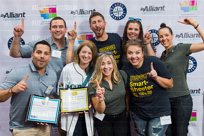 Employees of Smartsheet, recipient of the first place award for 2017 Washington's Best Workplaces (250+ employees), pose during the Puget Sound Business Journal's Washington's Best Workplaces event at Safeco Field in Seattle on Thursday, August 3 , 2017. (BUSINESS JOURNAL PHOTO | Dan DeLong)