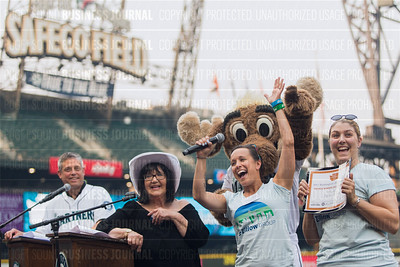 Heather Palmer, left, and Jessica Gandy of the Zillow Group, recipient of the third place award for 2017 Washington's Best Workplaces (250+ employees), accept the award during the Puget Sound Business Journal's Washington's Best Workplaces event at Safeco Field in Seattle on Thursday, August 3 , 2017. (BUSINESS JOURNAL PHOTO | Dan DeLong)