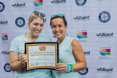 Jessica Gandy, left, and Heather Palmer of the Zillow Group, recipient of the third place award for 2017 Washington's Best Workplaces (250+ employees), pose during the Puget Sound Business Journal's Washington's Best Workplaces event at Safeco Field in Seattle on Thursday, August 3 , 2017. (BUSINESS JOURNAL PHOTO | Dan DeLong)