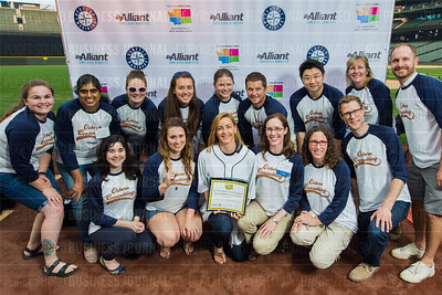 Tarelle Osborn, holding award, and employees of Osborn Consulting, Inc., recipient of the first place award for 2017 Washington's Best Workplaces (10-49 employees), pose during the Puget Sound Business Journal's Washington's Best Workplaces event at Safeco Field in Seattle on Thursday, August 3 , 2017. (BUSINESS JOURNAL PHOTO | Dan DeLong)
