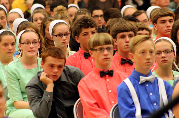 Roger Schneider | The Goshen News<br /> Robert McNamara (in the gray shirt), leans to get a view of the podium during the Westview eighth-grade graduation Wednesday.