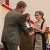 Roger Schneider | The Goshen News<br /> Kaylee Adelmann smiles as she receives the first eighth-grade graduation certificate Thursday from Principal Randy Miller.