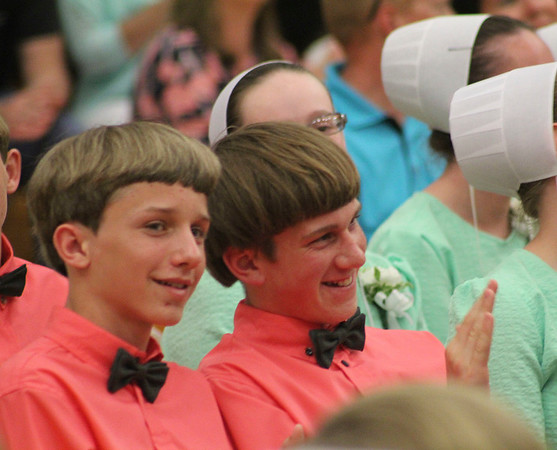 Roger Schneider | The Goshen News<br /> Tyler Wingard, left, and Aaron Yoder, enjoy their eighth-grade graduation and awards ceremony Wednesday.