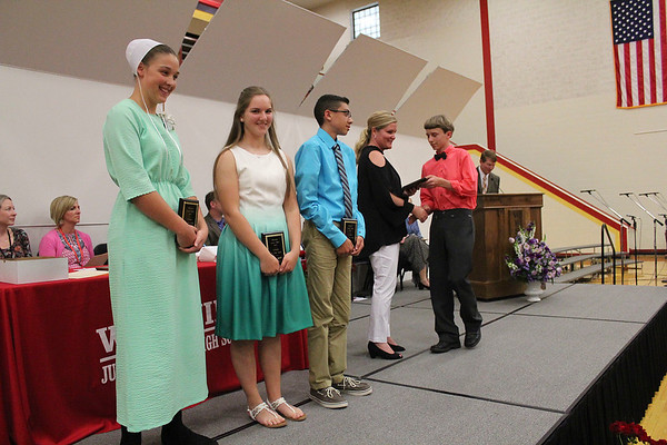 Roger Schneider | The Goshen News<br /> Jennifer May, school counselor, hands Tyler Wingard his citizenship award. Other recipients of Westview Jr.-Sr. High School's top award for eighth-graders are, from left, Bethany Lambright, Mary Beth Hostetler and Payton Oliver.