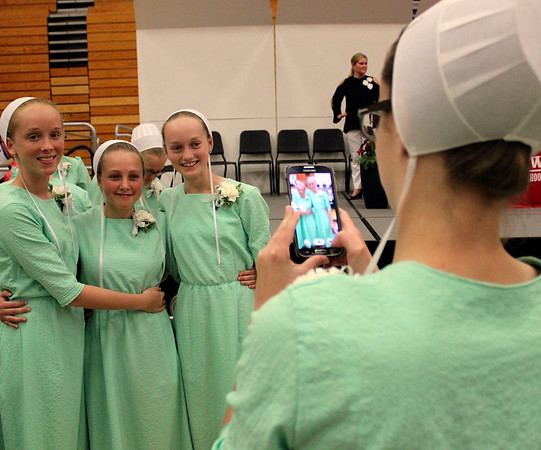 Kaylena Yoder takes a photo of her friends, from lef, Kara Miller, Eva Yoder and Alaina Bontrager after the eighth-grade graduation and awards ceremony at Westview Jr.-Sr. High School Wednesday.