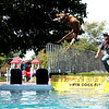 Shane Stover of Stewart, IL, brought Jake and Lucy, both Chesapeake Bay Retrievers, to participate in the Ultimate Air Dogs competition at Yorkville's Hometown Days over the weekend. The event pits dogs against each other, to see who can jump the farthest into a large pool of water.