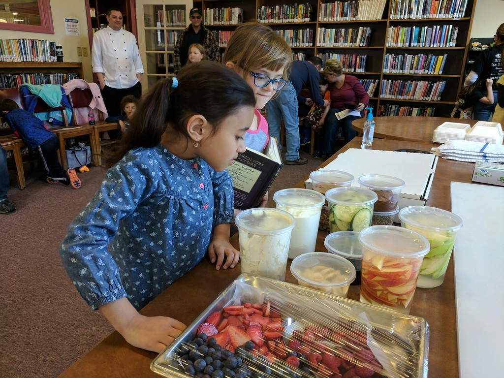 . Leah McDonald - Oneida Daily Dispatch Itzabelle Sanchez, 7, left, and Kaitlyn Myers, 7, check out the sandwich ingredients at the Oneida Public Library\'s Family Super Saturday cooking program on Saturday, March 4, 2017.