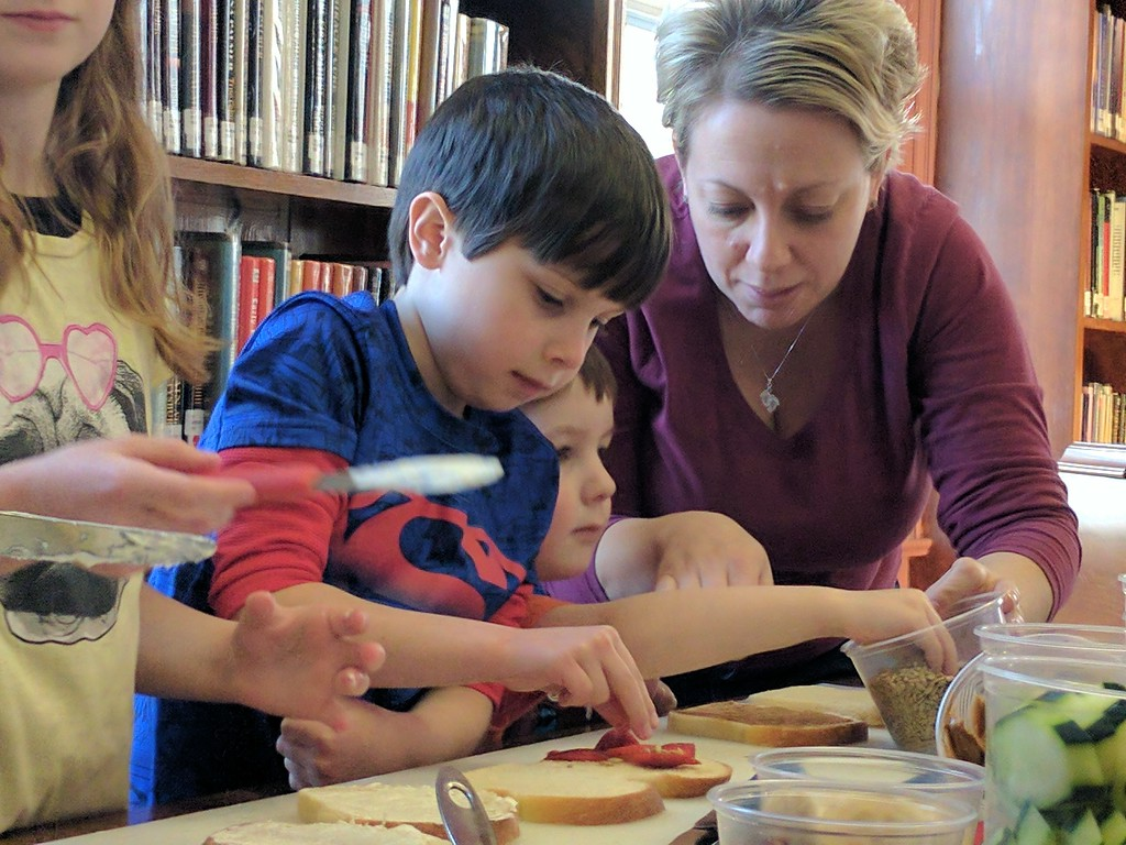 . Leah McDonald - Oneida Daily Dispatch Dean Gillander, 6, left, and Caleb Mannix, 3, make sandwiches at the Oneida Public Library\'s Family Super Saturday cooking program on Saturday, March 4, 2017.