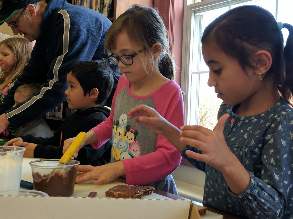 . Leah McDonald - Oneida Daily Dispatch Itzabelle Sanchez, 7, right, and Kaitlyn Myers, 7, make sandwiches at the Oneida Public Library\'s Family Super Saturday cooking program on Saturday, March 4, 2017.