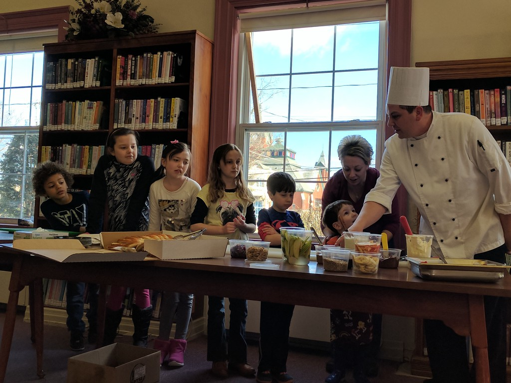 . Leah McDonald - Oneida Daily Dispatch Chef Jim Burdick talks about sandwich-making ingredients at the Oneida Public Library\'s Family Super Saturday cooking program on Saturday, March 4, 2017.