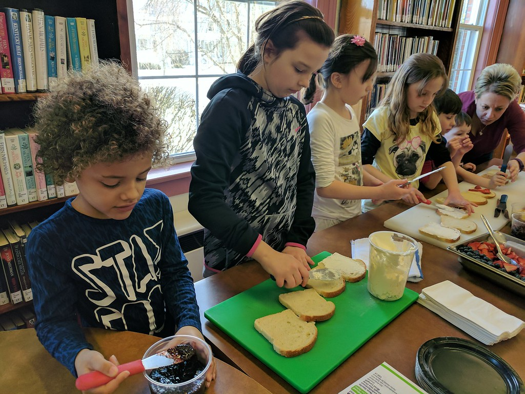 . Leah McDonald - Oneida Daily Dispatch Local kids show off their sandwich-making skills at the Oneida Public Library\'s Family Super Saturday cooking program on Saturday, March 4, 2017.