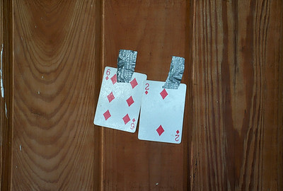 From a long unused Party/ Rec room: Two cards taped to the wall?