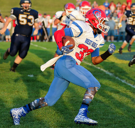 CHAD WEAVER | THE GOSHEN NEWS<br /> West Noble receiver Spencer Shrock breaks free for a big gain after taking the handoff on an end around during the first quarter of Friday night's game at Fairfield.