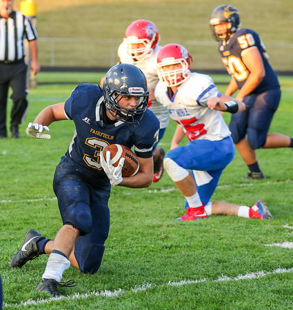 CHAD WEAVER   THE GOSHEN NEWS<br /> Fairfield running back Michael Shetler cuts upfield after taking a handoff during the second quarter of Friday night's game at Fairfield.