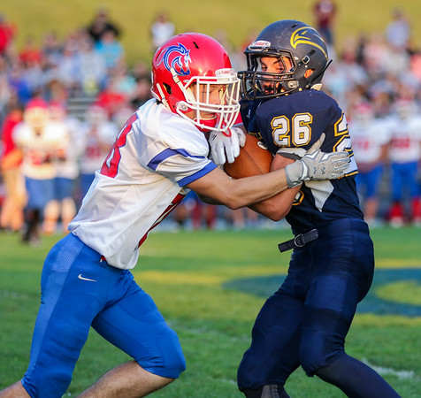 CHAD WEAVER   THE GOSHEN NEWS<br /> Fairfield running back Cooper Abramson tries to break away from West Noble defensive back Steven Loy after making a catch during the second quarter of Friday night's game at Fairfield.